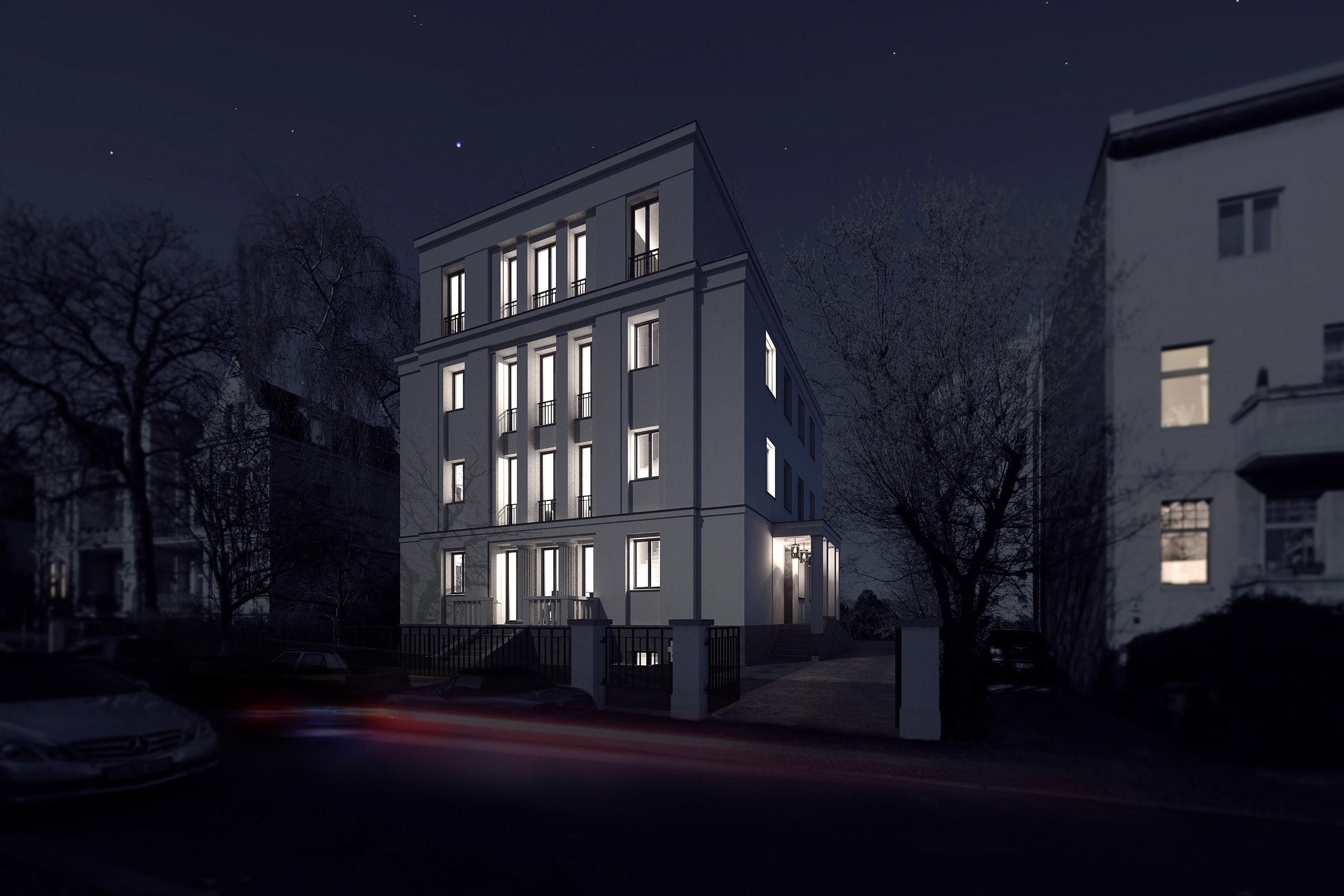 Nachts wird die Gebäudekonzeption mit dem Rückrat zentraler Räume stärker erlebbar.