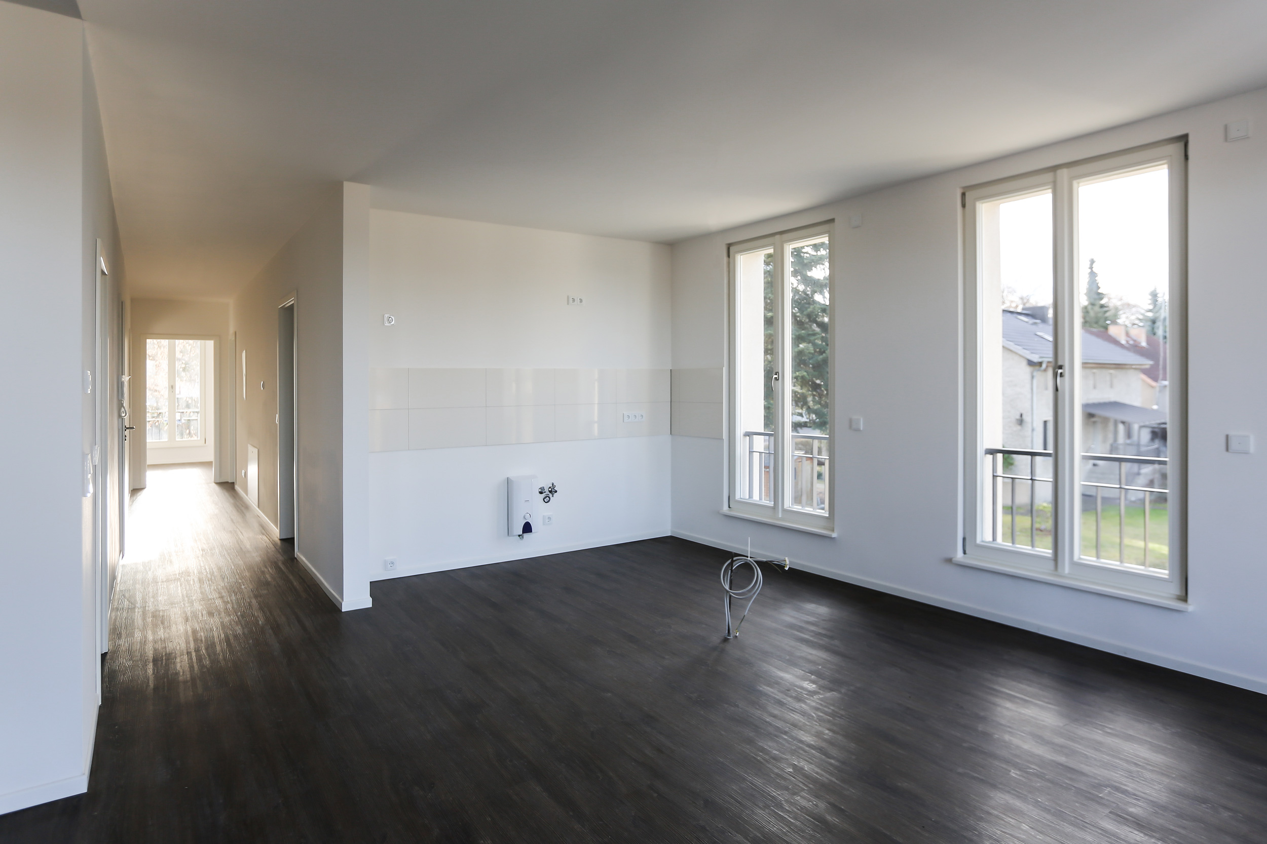 Neubau von Eigentumswohnungen im traditionellen Stil Berlin - In den Wohnbereichen sind Kochen und Essen kombiniert.